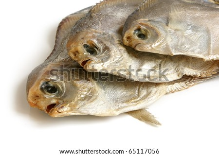 Dried piranhas on white background