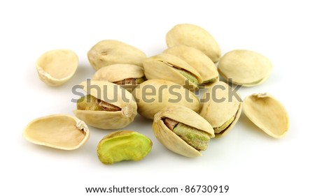 Dried pistachios on a white background