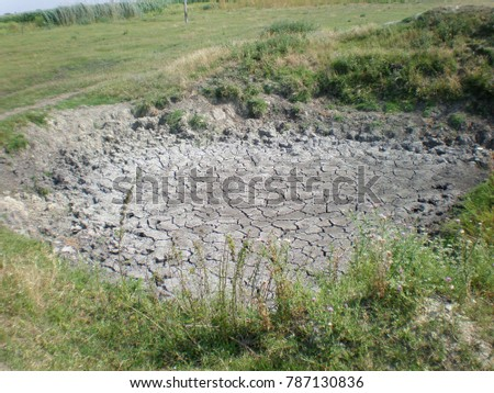 Dried ponds and mud during the long summer dry season in the open area of ??the meadow #787130836