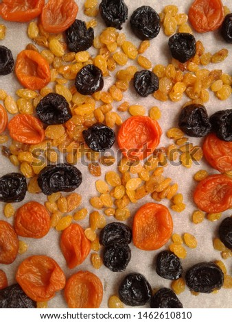 dried prunes, dried apricots, raisins