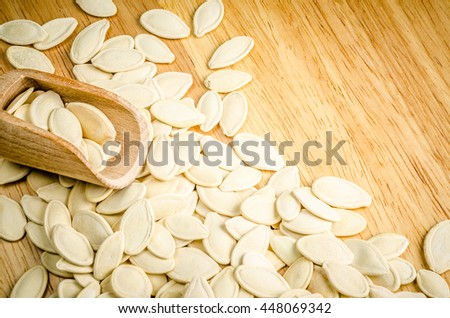 dried pumpkin seeds, on wooden background #448069342