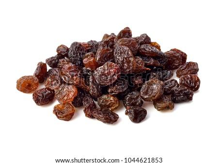 Dried raisins on white background. Stock photo ©