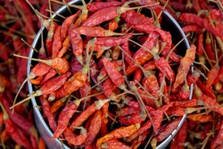 Dried red chili or chilli cayenne pepper. Food background.