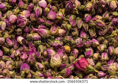 Dried rosebuds background texture closeup. violet rosebud close up of heap #1066506371