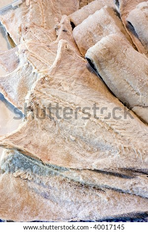 dried salted cod, fillets of fish preserved in salt
