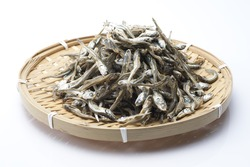 Dried sardine on bamboo basket