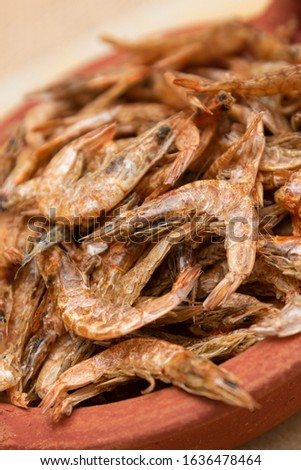 Dried shrimps that are sun-dried for preservation purposes. Used in many Asian cuisines as dry seafood. Preserving food by drying with sunlight