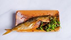 Dried smoked shamayka fish (Danube bleak or Caspian shemaya) with herbs isolated on white