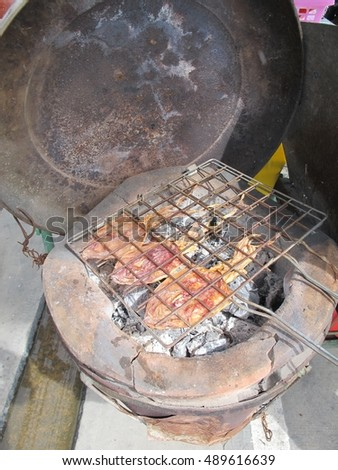 Dried squid, grilled on charcoal #489616639