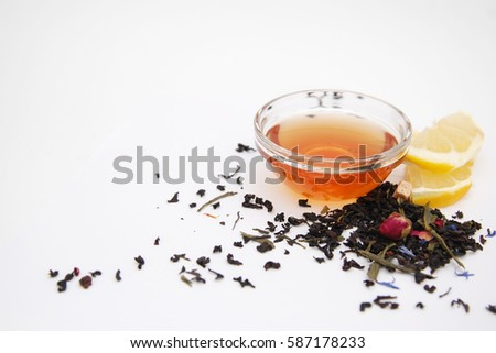 Dried tea leaves strung on old white background #587178233