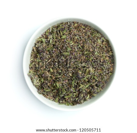 Dried thyme in a bowl on white background