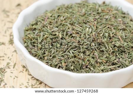 dried thyme in a white bowl, closeup