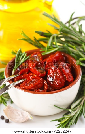 Dried tomatoes, garlic, rosemary and olive oil.