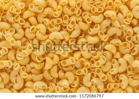 Dried uncooked macaroni little noodle above view macro