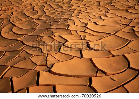 Dried up cracked river bed - stock photo