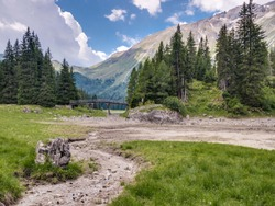 Dried-up lake Obernberger See in the Tyrolean alps in July. Obernberg am Brenner, Tyrol, Austria