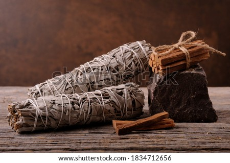 Dried white sage smudge sticks for relaxation and aromatherapy. Essential incense for esoteric rituals .Organic burning sage smudge. Stock photo ©