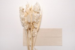 Dried wildflowers with envelope. Eco style in design. Top view, flat lay