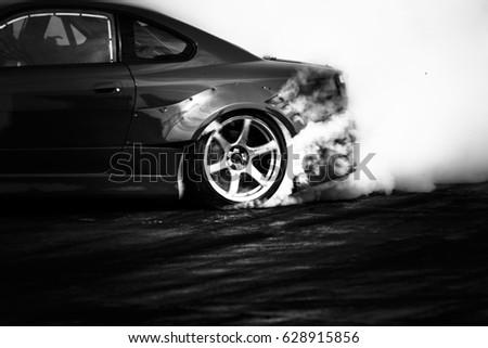 Drift car, Car wheel drifting and smoking on track.