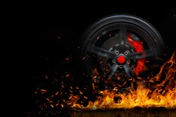 Drifting and fire smoking sport car tire with red breaks isolated on a black background