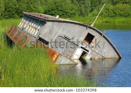 Drifting barge on river - stock photo