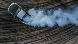 Drifting car, Aerial top view professional driver drifting car on race track, Abstract texture and background black tire tracks skid on asphalt road, Wheel tire tracks background, Car tire track.