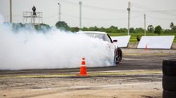 Drifting car for the race, Drag racing car burns rubber off its tires in on speed race track.