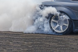 Drifting car, Sport car wheel drifting and smoking on track, Abstract texture and background black tire tracks skid on asphalt road, Wheel tire tracks background, Car tire track skid mark.