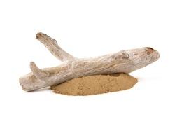 Driftwood on sand isolated on white background. Piece of coastal weathered wood on sand pile.