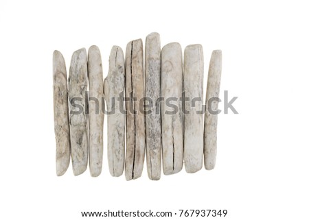Driftwood. row of white sea snags isolated on white background. Flat lay, top view, copy space. - Shutterstock ID 767937349