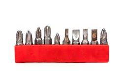 Drill bit holder collection in a red case isolated on white background, closeup, frontal view