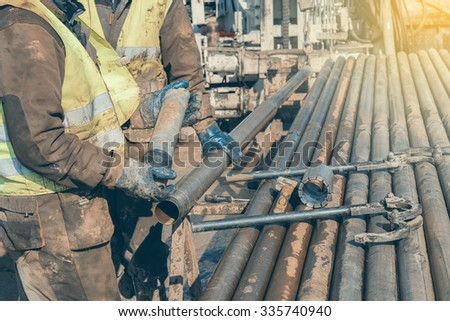 drill core worker hands holding ...