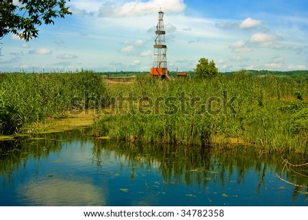 Drill derrick in the natural landscape