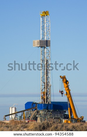 drill rig set up for winter drilling in Wyoming - stock photo