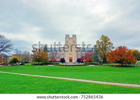 Drillfield view of Burrus Hall at Virginia Tech during the fall with orange and maroon colors, Virginia, USA