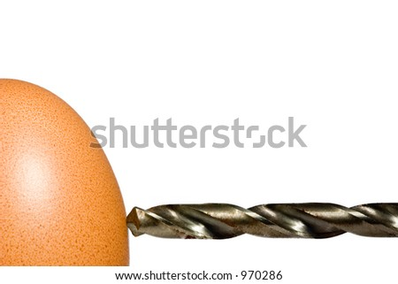 Drilling an egg - stock photo