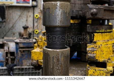 Drilling pipe. Rusty drill pipes were drilled in the well section. Downhole drilling rig. Laying the pipe on the deck. View of the shell of drill pipes and pipes laid in the open courtyard of the oil