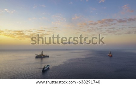 Drilling platforms in the ocean at sunrise, view from the air #638291740