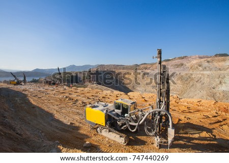 Drilling rig for blasting activities