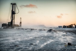 Drilling rig works on the Arctic island.