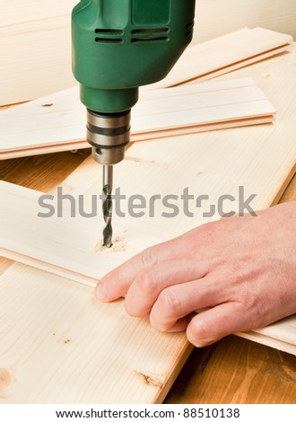 Drilling wooden plank