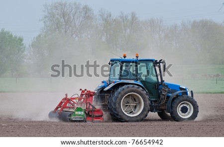 DRIMMELEN, NORTH-BRABANT, NETHERLANDS - APRIL 27: Milling of a very dry field in Drimmelen, Netherlands on April 27, 2011. The soil is very dry in Holland because almost no rain has fallen lately.