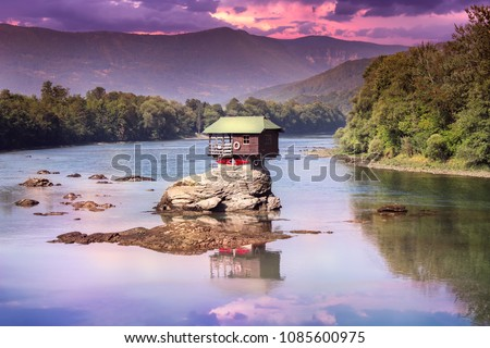 Drina house dramatic sunset and reflection - Colorful little house on the rock on the middle of the Drina river in west Serbia, one of the most popular attractions of this area Stock photo ©