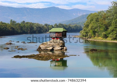 Drina house reflection - Colorful little house on the rock on the middle of the Drina river in west Serbia, one of the most popular attractions of this area Stock photo ©