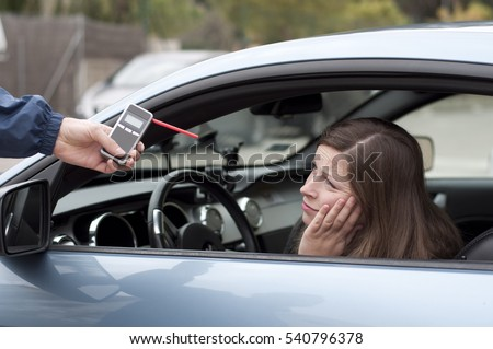 drink and drive crashed young female driver due to being subject to test for alcohol content with use of breathalyzer. she is devastated #540796378