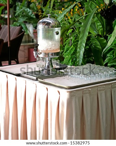 Drink dispenser and glasses in a hotel with ice