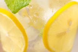 Drink for hot summer days. Fresh lime and lemon lemonade. Selective focus
