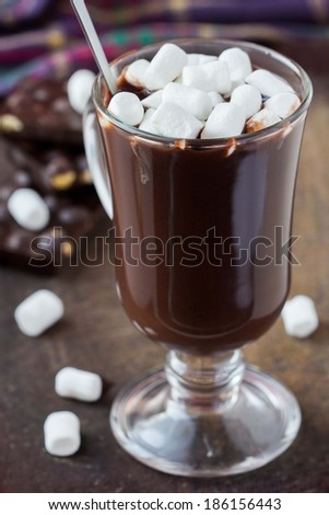 Drink hot chocolate with marshmallows in transparent glass, tasty sweet