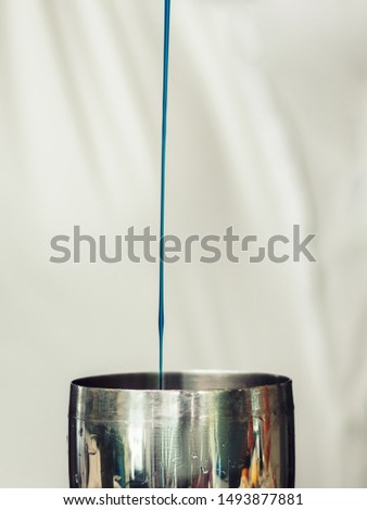 Drink poured in shaker on light background #1493877881