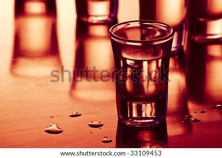 drink shots with reflection and drops in bar